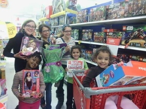 HopeMatch volunteers with Christmas gifts for children