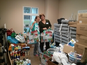 HopeMatch volunteers with lots of household stuff that will be donated to families