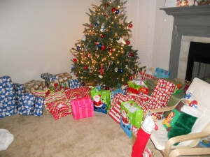 Decorated Christmas tree and lots of gifts that HopeMatch gives to underprivileged families
